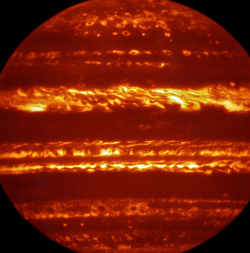 In preparation for the imminent arrival of NASA's Juno spacecraft in July 2016, astronomers used ESO's Very Large Telescope to obtain spectacular new infrared images of Jupiter using the VISIR instrument. This false-colour image was created by selecting and combining the best images obtained from many short VISIR exposures at a wavelength of 5micrometres. Image credit: ESO/L. Fletcher.
