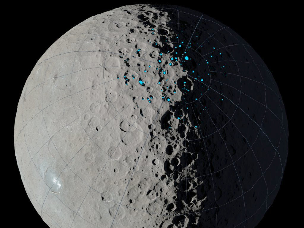 """At the poles of Ceres, scientists have found craters that are permanently in shadow (indicated by blue markings). Such craters are called """"cold traps"""" if they remain below about -240°F (-151°C). These shadowed craters may have been collecting ice for billions of years because they are so cold. Image credit: NASA/JPL-Caltech/UCLA/MPS/DLR/IDA."""