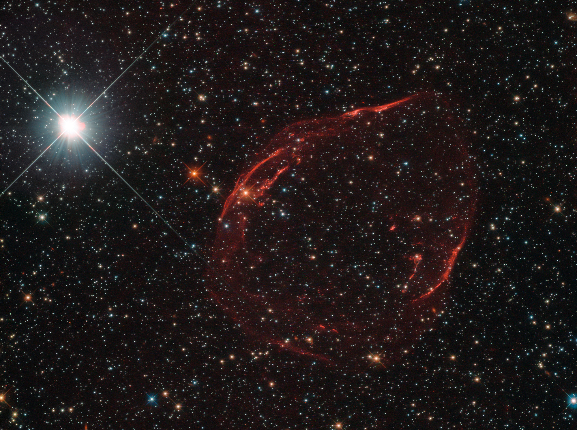 DEM L71 is a supernova remnant (α=05h05.7m, δ=-67°53' J2000) located about 160,000 light-years away in the Large Magellanic Cloud, a close neighbouring galaxy in the far southern constellation of Dorado (the swordfish). This image captured with the NASA/ESA Hubble Space Telescope is just 2.68 x 2.0arcminutes wide. Click the picture for a larger-scale version. Image credit: ESA/Hubble & NASA, Y. Chu.
