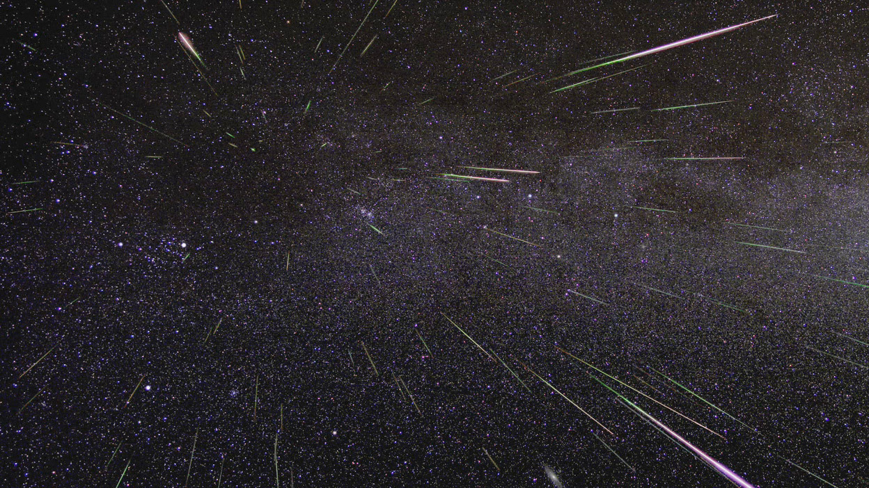 This time-lapse image of a Perseid shower shows that they appear to originate from a point in the constellation of Perseus — the radiant — close to the so-called Double Cluster, a pair of open star clusters just to the left of centre. The radiant is a phenomenon of perspective since the meteors are entering the Earth's atmosphere in approximately parallel paths. Note the rich backdrop of Milky Way stars and the Andromeda Galaxy at the bottom of the picture, just right of centre. Image credit: NASA.