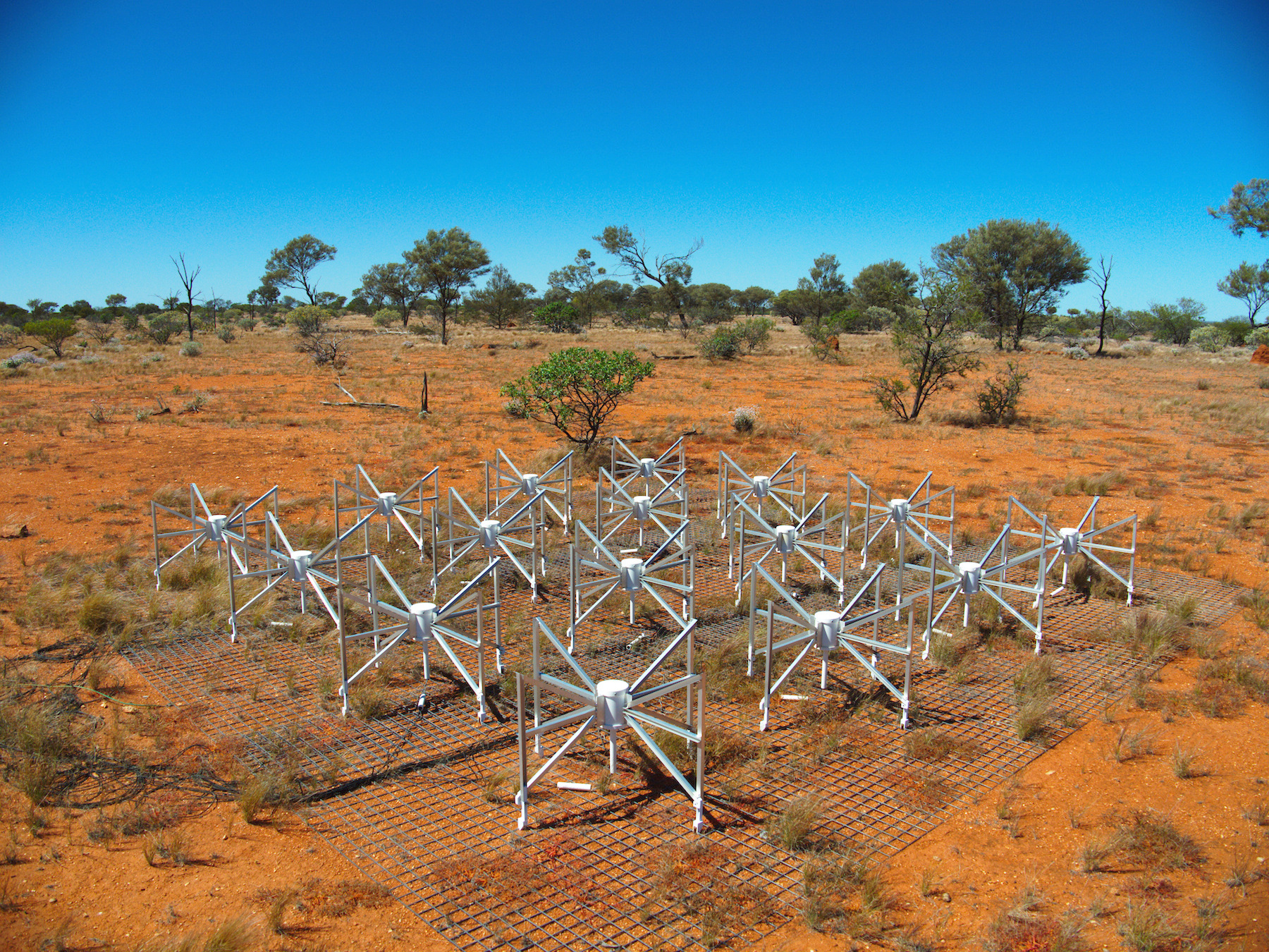 """One """"tile"""" of the Murchison Wide-field Array telescope in Australia. In preparation for looking for the first generation of galaxies, the facility has published the first catalogue of extragalactic sources of contamination in one of the fields of view. Image credit: Murchison Wide-field Array."""