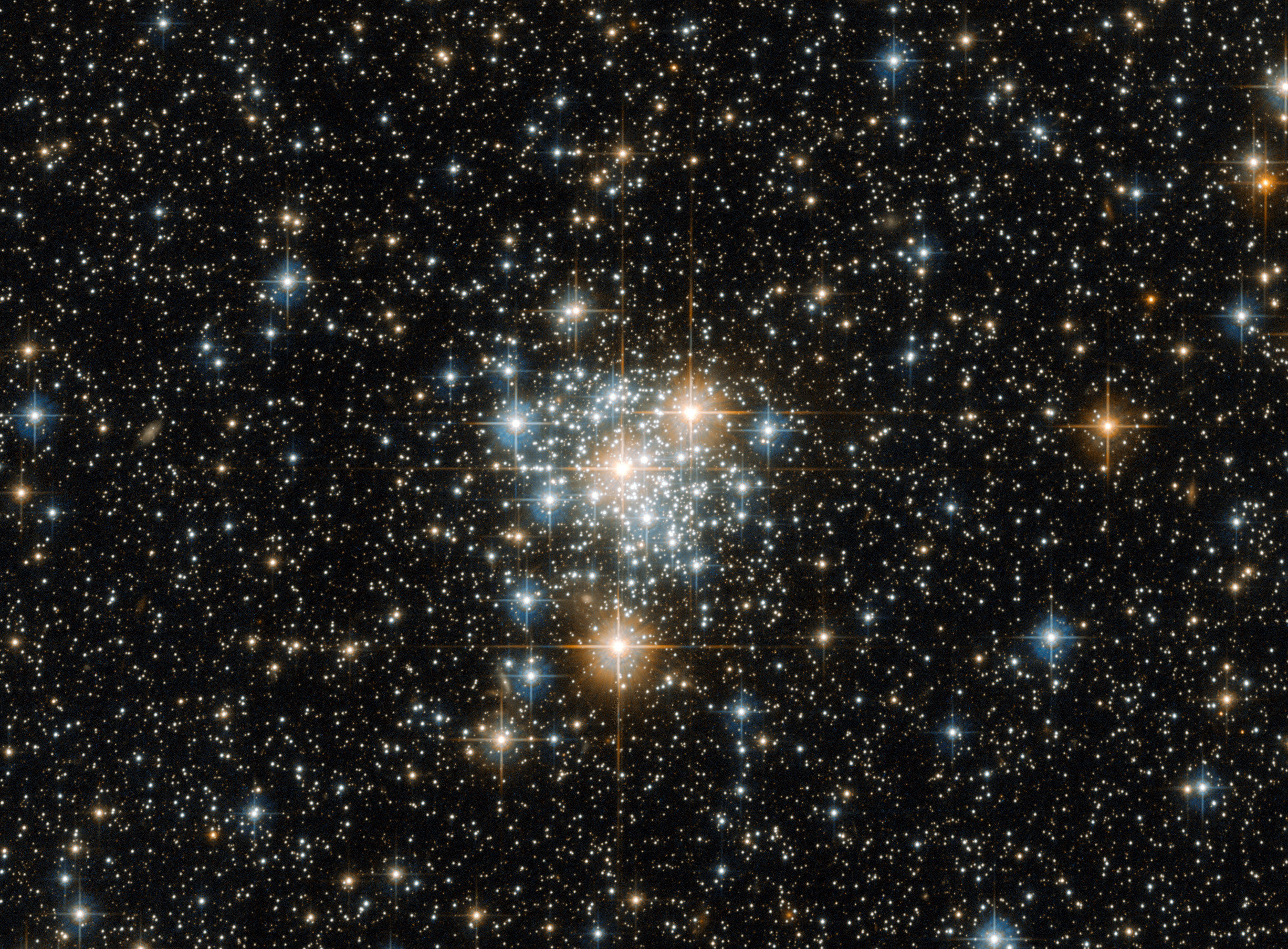 This NASA/ESA Hubble Space Telescope view of magnitude +11.7 open cluster NGC299 shows a field of view of 2.04 x 1.51 arcminutes. The cluster lies 200,000 light-years away within the Small Magellanic Cloud in the constellation of Tucana (The Toucan), α=00h53.4m, δ=-72°12' (J2000.0). Click the picture for a full-size version. Image credit: ESA/Hubble & NASA.