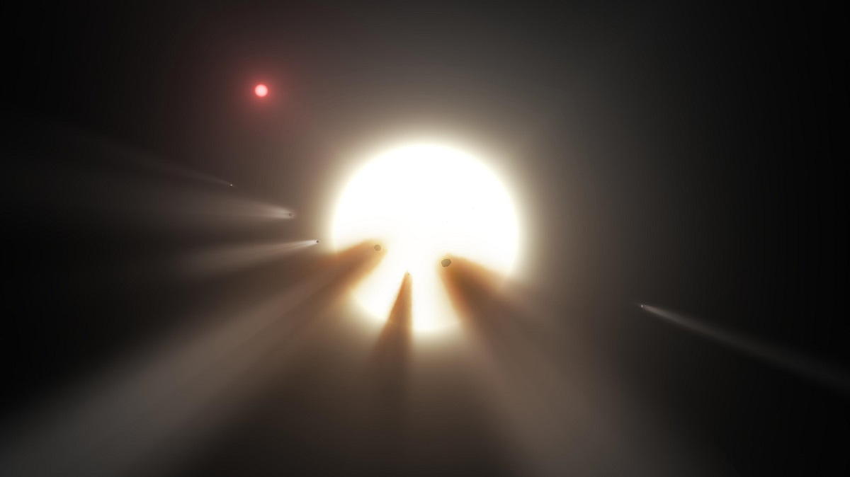 This artist's conception shows a star behind a shattered comet. One of the theories for KIC 8462852's unusual dimming is the presence of debris from a collision or breakup of a planet or comet in the star's system, creating a short-term cloud that blocks some starlight. Image credit: NASA/JPL-Caltech.