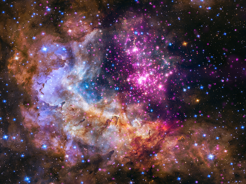 Westerlund2 is a cluster of young stars — about one to two million years old — located about 20,000 light-years from Earth in the southern constellation of Carina. Data in visible light from the NASA/ESA Hubble Space Telescope (green and blue) reveal thick clouds where the stars are forming. High-energy radiation in the form of X-rays, however, can penetrate this cosmic haze and are detected by Chandra (purple). Image credit: X-ray: NASA/CXC/SAO/Sejong Univ./Hur et al; Optical: NASA/STScI.