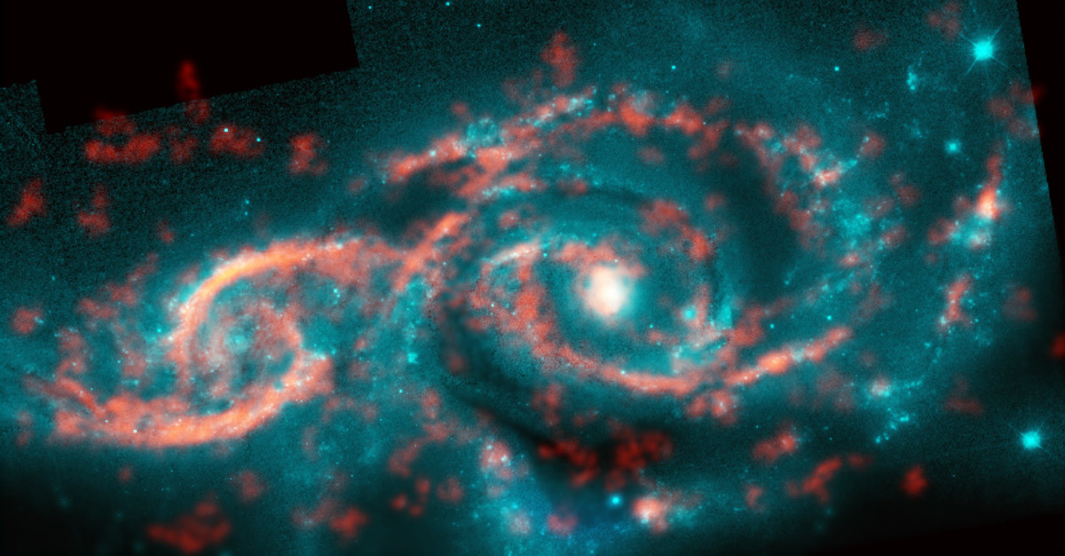 Galaxies IC2163 (left) and NGC2207 (right) recently grazed past each other, triggering a tsunami of stars and gas in IC2163 and producing the dazzling eyelid-like features there. ALMA image of carbon monoxide (orange), which revealed motion of the gas in these features, is shown on top of Hubble image (blue) of the galaxy pair. Image credit: M. Kaufman; B. Saxton (NRAO/AUI/NSF); ALMA (ESO/NAOJ/NRAO); NASA/ESA Hubble Space Telescope.