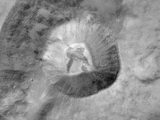 Image of a 1.4kilometre-sized crater (left centre) near the Martian equator. It was acquired at a resolution of 7.2metres/pixel by the Colour and Stereo Surface Imaging System (CaSSIS) camera onboard ESA's ExoMars Trace Gas Orbiter. The images are very sharp and show the instrument is working extremely well at its nominal data acquisition rates. Image credit: © ESA/Roscosmos/ExoMars/CaSSIS/UniBE.