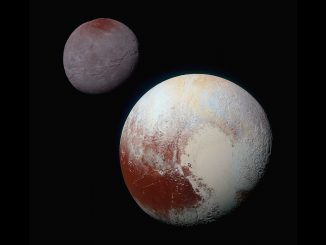 """Pluto, shown here in the front of this false-colour image, has a bright ice-covered """"heart."""" The left, roughly oval lobe is the basin provisionally named Sputnik Planitia. Sputnik Planitia appears directly opposite Charon, Pluto's tidally locked moon (back). Image credit: NASA/JHUAPL/SWRI."""