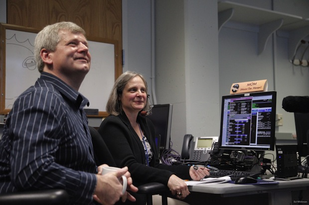New Horizons mission operations team member Karl Whittenburg and mission operations manager Alice Bowman watch screens for data confirming that the New Horizons spacecraft had transitioned from hibernation to active mode on Dec. 6. Credit: APL