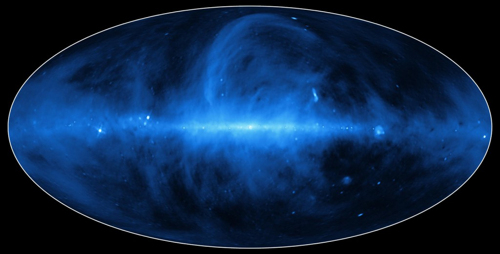 Captured in Magnetic Fields. Blue indicates a type of radiation called synchrotron, which occurs when fast-moving electrons, spit out of supernovas and other energetic phenomena, are captured in the galaxy's magnetic field, spiraling along them near the speed of light. Image credit: ESA/NASA/JPL-Caltech
