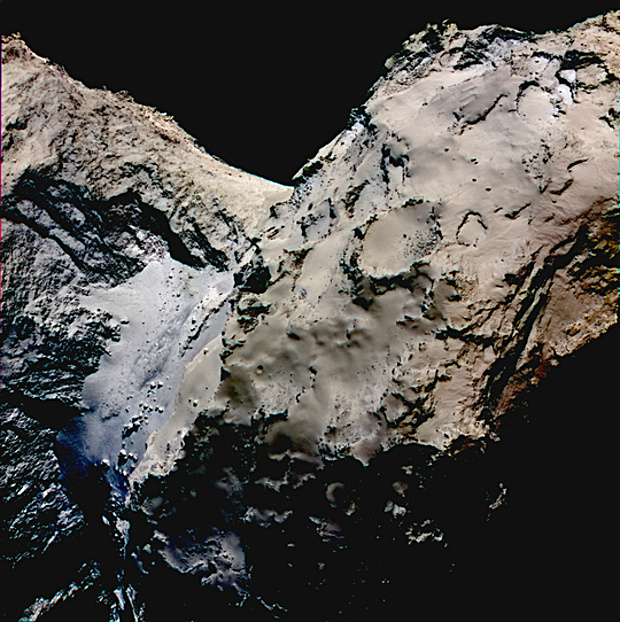 False colour image showing the smooth Hapi region connecting the head and body of comet 67P/Churyumov-Gerasimenko. Differences in reflectivity have been enhanced in this image to emphasise the bluish colour of the Hapi region. The scientific data was acquired on 21th August 2014 by the scientific imaging system OSIRIS successively with the filters centred at 989, 700 and 480 nanometres and the images then superposed. During these observations Rosetta was 43 miles (70 km) far away from the comet. Image credit: ESA/Rosetta/MPS for OSIRIS Team MPS/UPD/LAM/IAA/SSO/INTA/UPM/DASP/IDA