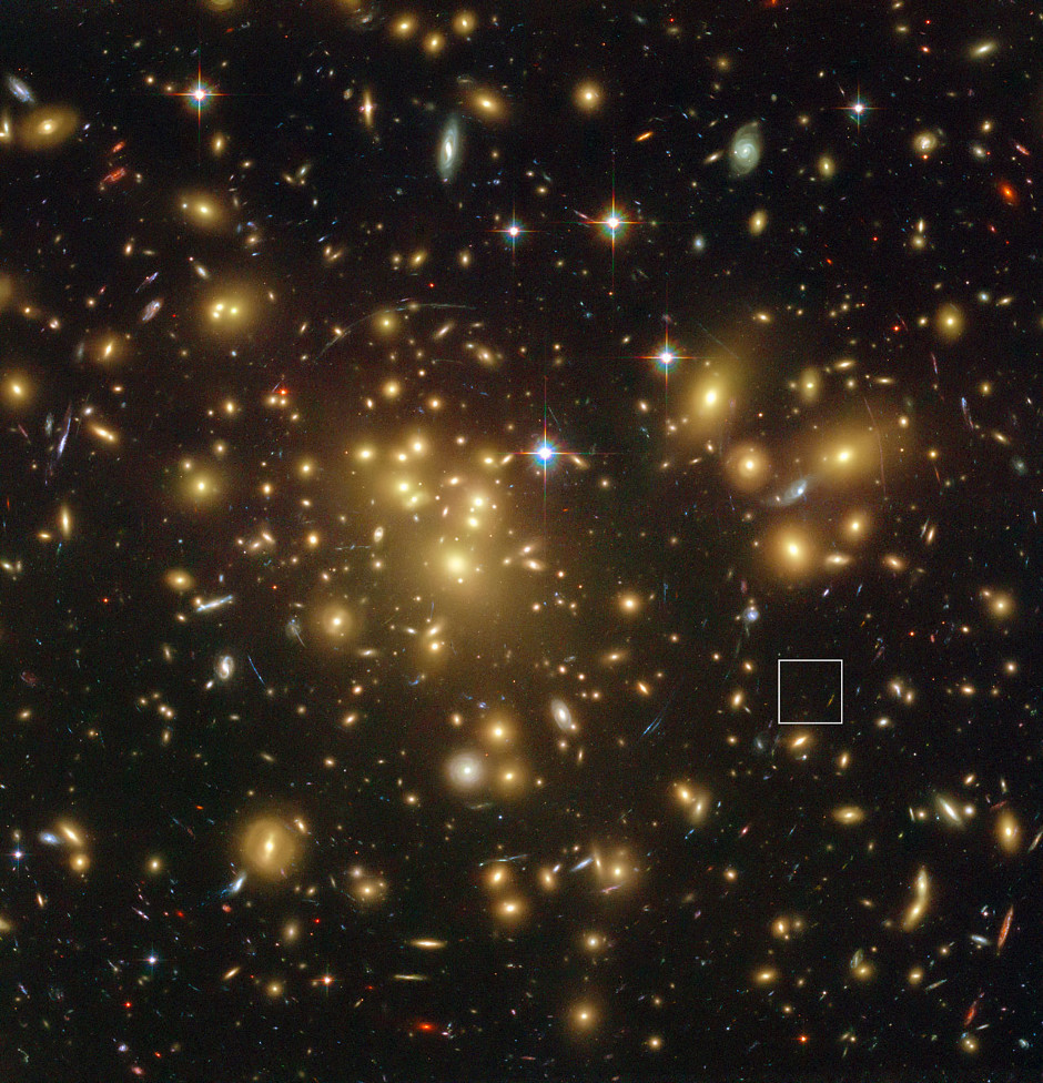 This spectacular view from the NASA/ESA Hubble Space Telescope shows the rich galaxy cluster Abell 1689. The huge concentration of mass bends light coming from more distant objects and can increase their total apparent brightness and make them visible. One such object, A1689-zD1, is located in the box — although it is still so faint that it is barely seen in this picture. New observations with ALMA and ESO's VLT have revealed that this object is a dusty galaxy seen when the universe was just 700 million years old. Image credit: NASA; ESA; L. Bradley (Johns Hopkins University); R. Bouwens (University of California, Santa Cruz); H. Ford (Johns Hopkins University); and G. Illingworth (University of California, Santa Cruz)