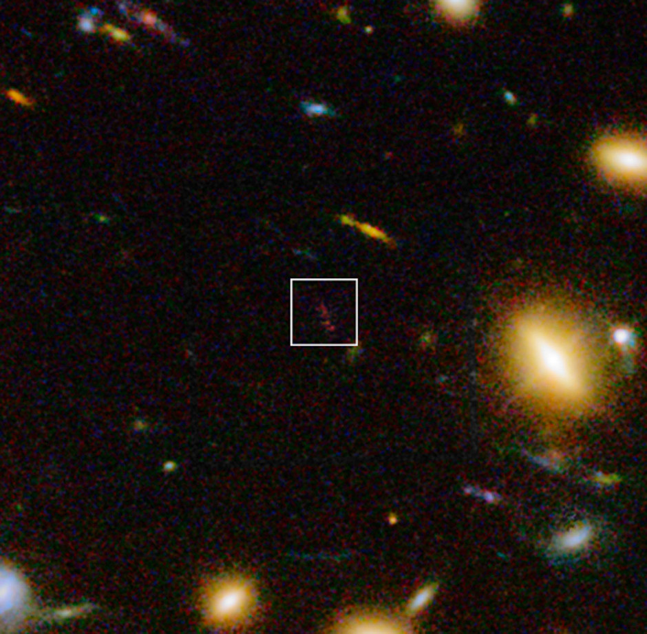 This view includes infrared light images from the WFC3 instrument on the NASA/ESA Hubble Space Telescope as well as visible light views. It shows a close up look at part of the rich galaxy cluster Abell 1689 showing galaxy A1689-zD1 as the elongated reddish object in the box. Image credit: ESO/J. Richard