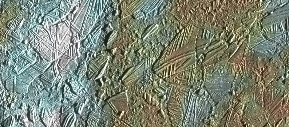 Bizarre features on Europa's icy surface suggest a warm interior. This view of the surface of Jupiter's moon Europa was obtained by NASA's Galileo mission, and shows a colour image set within a larger mosaic of low-resolution monochrome images. Galileo was able to survey only a small fraction of Europa's surface in colour at high resolution; a future mission would include a high-resolution imaging capability to capture a much larger part of the moon's surface. Image credit: NASA/JPL-Caltech.