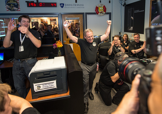 New Horizons' principal investigator Alan Stern celebrates the reception of the first signals from the spacecraft after its Pluto flyby. Credit: NASA/Bill Ingalls