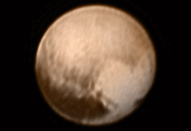 This image of Pluto from New Horizons' Long Range Reconnaissance Imager (LORRI) was received on 8 July, and has been combined with lower-resolution colour information from the Ralph instrument. The image was taken on 7 July, when the spacecraft was just under 5 million miles (8 million kilometres) from Pluto, and is the first to be received since the 4 July anomaly that sent the spacecraft into safe mode. Image credits: NASA-JHUAPL-SWRI.
