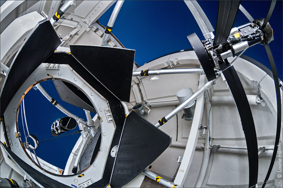 Inside the dome of the Automated Planet Finder at Lick Observatory showing the 2.4-metre primary mirror uncovered. Image credit: Laurie Hatch.