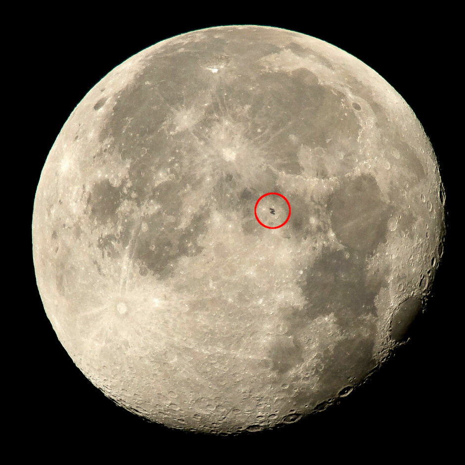 Like any object in low Earth orbit, the International Space Station (ISS) can can occasionally pass in front of (transit) more distant objects — in this case, the Moon. The ISS (circled) is seen in silhouette as it transits the lunar surface at roughly five miles per second at 4:41amEDT on Sunday, 2 August 2015 as seen from Woodford, Virginia, USA. Onboard the ISS are; NASA astronauts Scott Kelly and Kjell Lindgren: Russian Cosmonauts Gennady Padalka, Mikhail Kornienko, Oleg Kononenko, and Japanese astronaut Kimiya Yui. The International Space Station makes several visible passes over the BritishIsles during the first ten days of August. Image credit: NASA/BillIngalls.