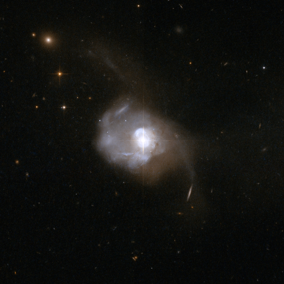 Markarian 231 (UGC 8058) is a Type-1 Seyfert galaxy in Ursa Major that was discovered in 1969 as part of a search of galaxies with strong ultraviolet radiation. Results from the first spectrum showed clear signs of the presence of a powerful central quasar. Image credit: NASA, ESA, the Hubble Heritage (STScI/AURA)-ESA/Hubble Collaboration, and A. Evans (University of Virginia, Charlottesville/NRAO/Stony Brook University).