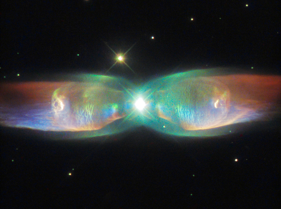 Known variously as the Butterfly Nebula, Minkowski's Butterfly, the Twin Jet Nebula, or PN M2-9, this is a striking example of a bipolar planetary nebula. It lies 2,100 light-years away in the constellation Ophiuchus. Bipolar planetary nebulae are formed when the central object is not a single star, but a binary system. Studies have shown that the nebula's size increases with time, and measurements of this rate of increase suggest that the stellar outburst that formed the lobes occurred just 1200 years ago. Image credit: ESA/Hubble & NASA Acknowledgement: Judy Schmidt.