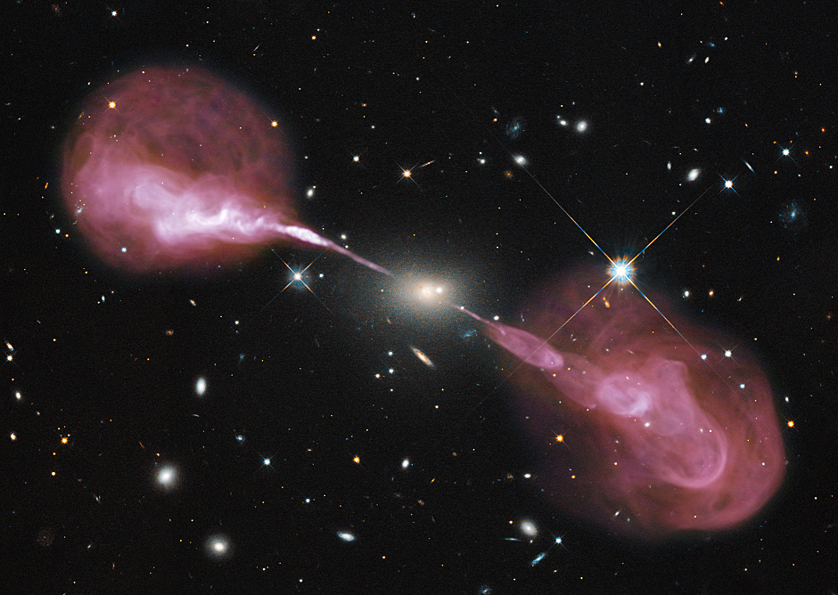 Spectacular jets powered by the gravitational energy of a supermassive black hole in the core of the elliptical galaxy Hercules A illustrate the combined imaging power of two of astronomy's cutting-edge tools, the Hubble Space Telescope's Wide Field Camera 3, and the Karl G. Jansky Very Large Array (VLA) radio telescope in west-central New Mexico. Image credit: NASA, ESA, S. Baum and C. O'Dea (RIT), R. Perley and W. Cotton (NRAO/AUI/NSF), and the Hubble Heritage Team (STScI/AURA).
