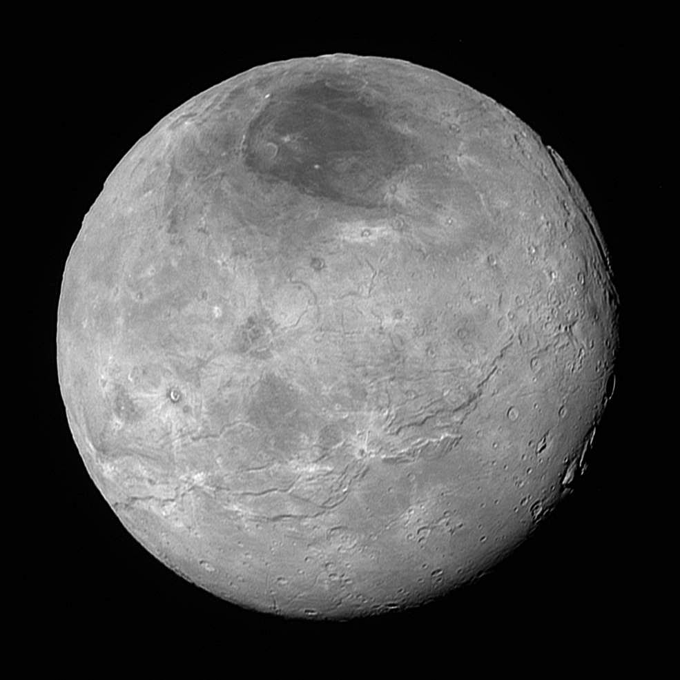 This image of Pluto's largest moon Charon, taken by NASA's New Horizons spacecraft 10 hours before its closest approach to Pluto on 14 July 2015 from a distance of 290,000 miles (470,000 kilometres), is a recently downlinked, much higher quality version of a Charon image released on 15 July. Charon, which is 750 miles (1,200 kilometres) in diameter, displays a surprisingly complex geological history, including tectonic fracturing; relatively smooth, fractured plains in the lower right; several enigmatic mountains surrounded by sunken terrain features on the right side; and heavily cratered regions in the center and upper left portion of the disc. There are also complex reflectivity patterns on Charon's surface, including bright and dark crater rays, and the conspicuous dark north polar region at the top of the image. The smallest visible features are 2.9 miles 4.6 kilometres) in size. Image credits: NASA/Johns Hopkins University Applied Physics Laboratory/Southwest Research Institute.