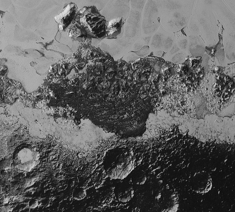 This 220-mile (350-kilometre) wide view of Pluto from NASA's New Horizons spacecraft illustrates the incredible diversity of surface reflectivities and geological landforms on the dwarf planet. The image includes dark, ancient heavily cratered terrain; bright, smooth geologically young terrain; assembled masses of mountains; and an enigmatic field of dark, aligned ridges that resemble dunes; its origin is under debate. The smallest visible features are 0.5 miles (0.8 kilometres) in size. This image was taken as New Horizons flew past Pluto on 14 July 2015, from a distance of 50,000 miles (80,000 kilometres). Image credits: NASA/Johns Hopkins University Applied Physics Laboratory/Southwest Research Institute.