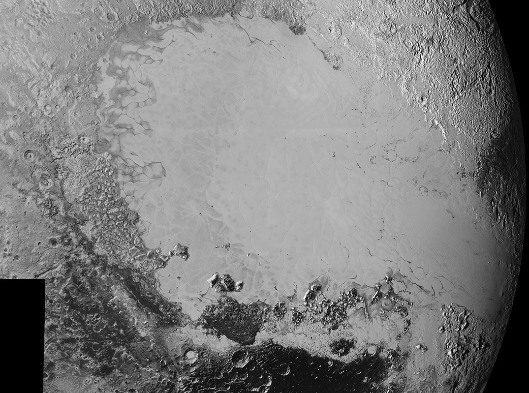 Mosaic of high-resolution images of Pluto, sent back from NASA's New Horizons spacecraft from 5—7 September 2015. The image is dominated by the informally-named icy plain Sputnik Planum, the smooth, bright region across the centre. This image also features a tremendous variety of other landscapes surrounding Sputnik. The smallest visible features are 0.5 miles (0.8 kilometres) in size, and the mosaic covers a region roughly 1,000 miles (1600 kilometres) wide. The image was taken as New Horizons flew past Pluto on 14 July 2015, from a distance of 50,000 miles (80,000 kilometres). Image credits: NASA/Johns Hopkins University Applied Physics Laboratory/Southwest Research Institute.