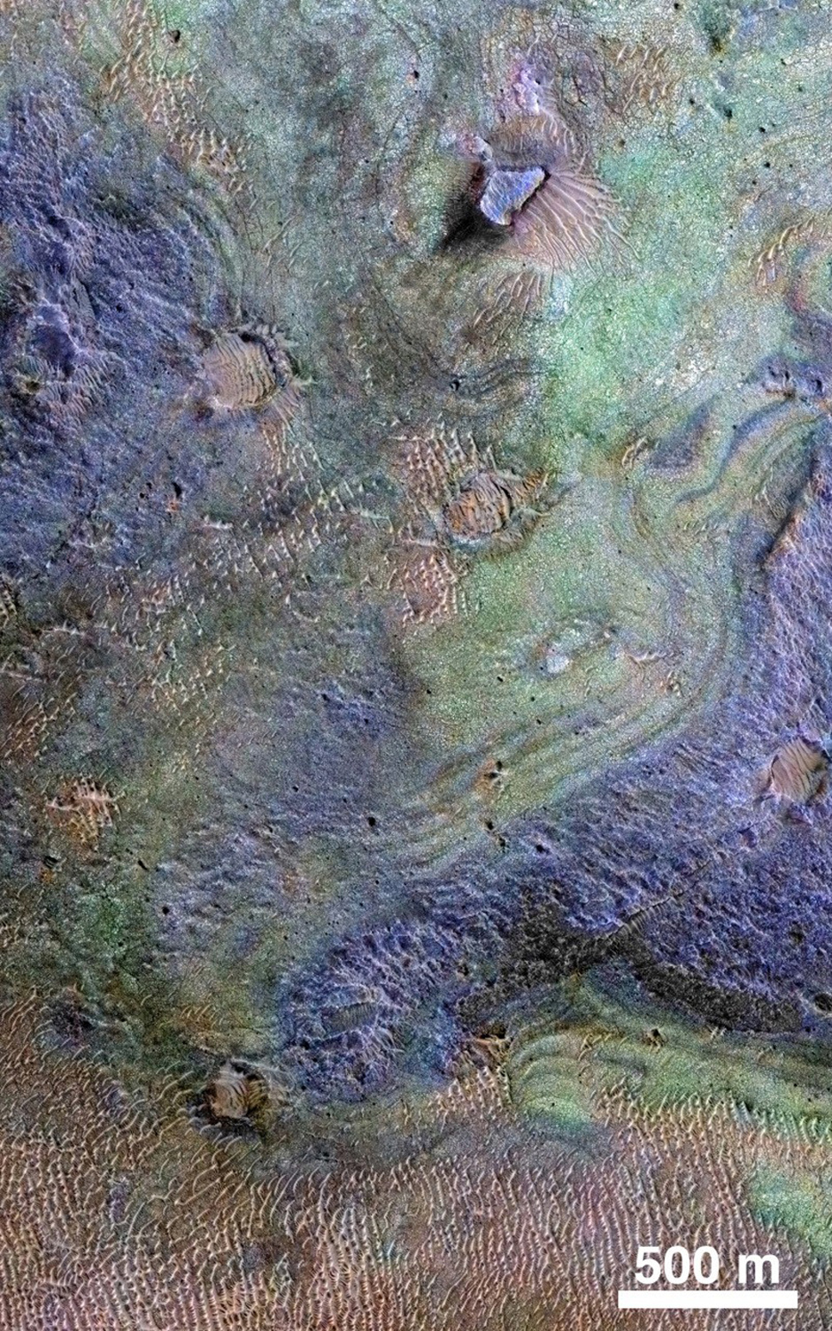 This view combines information from two instruments on NASA's Mars Reconnaissance Orbiter to map colour-coded composition over the shape of the ground in a small portion of the Nili Fossae plains region of Mars' northern hemisphere. This site is part of the largest known carbonate-rich deposit on Mars. In the colour coding used for this map, green indicates a carbonate-rich composition, brown indicates olivine-rich sands, and purple indicates basaltic composition. Image credit: NASA/JPL-Caltech/JHUAPL/Univ. of Arizona.