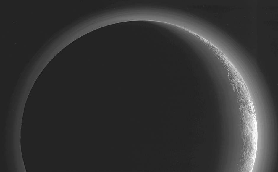 This image of Pluto was made just 15 minutes after New Horizons' closest approach on 14 July 2015, as the spacecraft looked back at Pluto toward the Sun. The wide-angle perspective of this view shows the deep haze layers of Pluto's atmosphere extending all the way around Pluto, revealing the silhouetted profiles of rugged plateaus on the night (left) side. The image was taken with New Horizons' Multi-spectral Visible Imaging Camera (MVIC) from a distance of 11,000 miles (18,000 kilometres) to Pluto. The resolution is 700 metres (0.4 miles). Image credit: NASA/JHUAPL/SwRI.