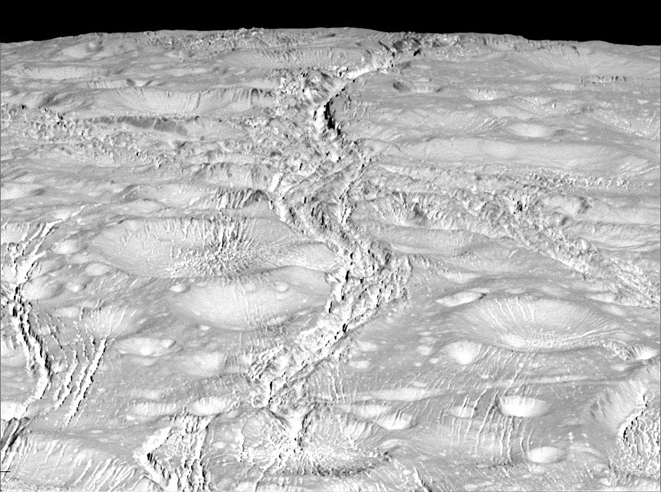 NASA's Cassini spacecraft zoomed by Saturn's icy moon Enceladus on 14October 2015, capturing this stunning image of the moon's north pole. A companion view from the wide-angle camera shows a zoomed out view of the same region for context. Scientists expected the north polar region of Enceladus to be heavily cratered, based on low-resolution images from the Voyager mission, but high-resolution Cassini images show a landscape of stark contrasts. Thin cracks cross over the pole — the northernmost extent of a global system of such fractures. Before this Cassini flyby, scientists did not know if the fractures extended so far north on Enceladus. North on Enceladus is up. The image was taken in visible green light with the Cassini spacecraft narrow-angle camera. Image credit: NASA/JPL-Caltech/Space Science Institute.