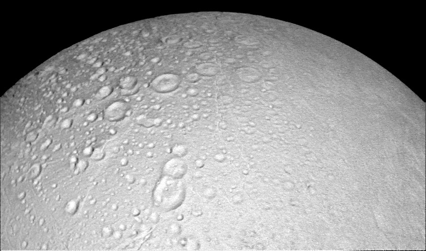 This view from NASA's Cassini spacecraft shows battered terrain around the north pole of Saturn's icy moon Enceladus. Craters crowd and overlap each other, each one recording an impact in the moon's distant past. The moon's north pole lies approximately at the top of this view from Cassini's wide-angle camera. A companion view from the narrow-angle camera shows the pole at a resolution about ten times higher. North on Enceladus is up. The image was taken in visible light by Cassini on 14October 2015. Image credit: NASA/JPL-Caltech/Space Science Institute.