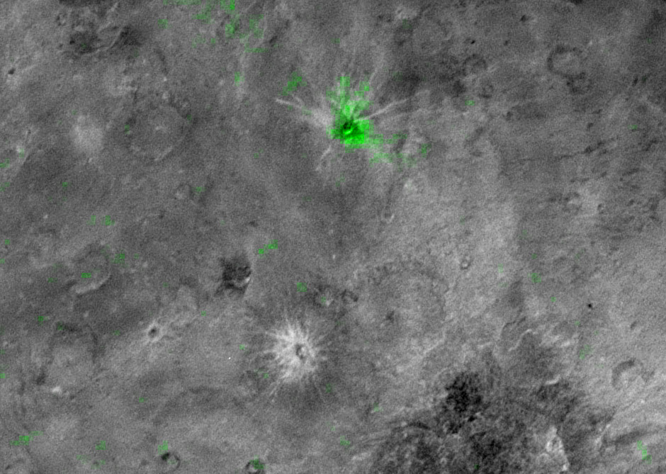 Charon's young ammonia crater. The informally named Organa crater (shown in green) is rich in frozen ammonia and — so far — appears to be unique on Pluto's largest moon. Image credits: NASA/JHUAPL/SwRI.