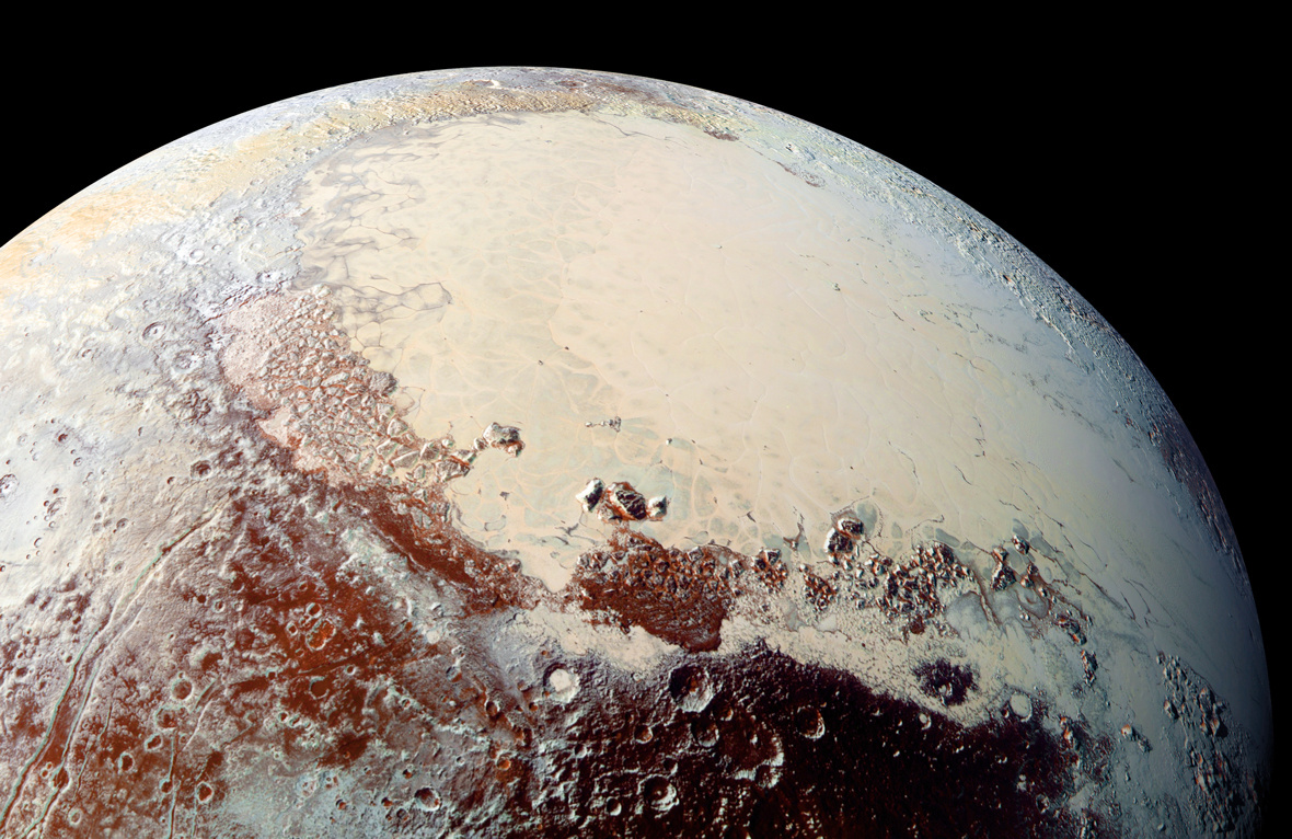 """This high-resolution image captured by NASA's New Horizons spacecraft combines blue, red and infrared images taken by the Ralph/Multispectral Visual Imaging Camera (MVIC). Pluto's surface shows a remarkable range of subtle colours, digitally enhanced in this view to a rainbow of pale blues, yellows, oranges, and deep reds. The bright expanse is the western lobe of the """"heart,"""" informally known as TombaughRegio. The lobe, informally called SputnikPlanum, has been found to be rich in nitrogen, carbonmonoxide, and methane ices. Pluto's diameter is 1,473miles (2,372kilometres). Image credit: NASA/Johns Hopkins University Applied Physics Laboratory/Southwest Research Institute."""