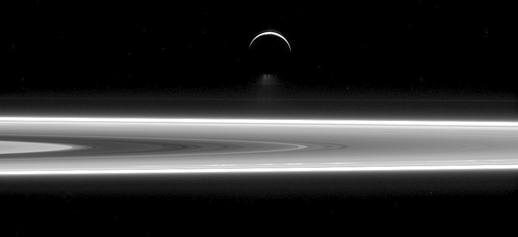 This view of Saturn's moon Enceladus narrowly above the ring plane of Saturn was captured by the narrow-angle camera of NASA's Cassini spacecraft on 29 July 2015 at a distance of approximately 630,000 miles (1.0 million kilometres) from Enceladus. Enceladus is subject to forces that heat a global ocean of liquid water under its icy surface, resulting in its famous south polar water jets which are just visible below the moon's dark, southern limb. Image credit: NASA/JPL-Caltech/Space Science Institute.