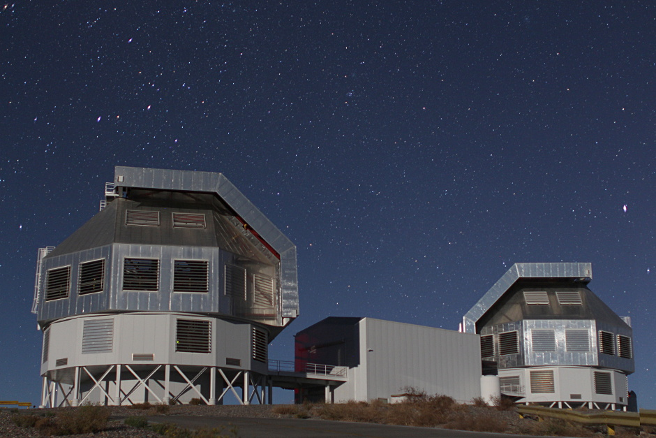 The twin 6.5-metre Magellan Telescopes at Las Campanas Observatory in Chile. The two telescopes are named after the astronomer Walter Baade (left) and the philanthropist Landon T. Clay (right). The Clay telescope (Magellan II) is equipped an adaptive optics system for high-resolution imaging. Image credit: Jan Skowron CC BY-SA 3.0