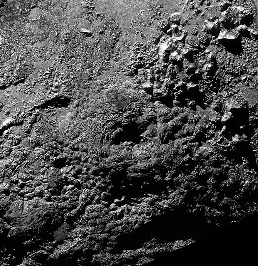 The informally named feature Wright Mons, located south of Sputnik Planum on Pluto, is an unusual feature that's about 100 miles (160 kilometres) wide and 13,000 feet (4 kilometres) high. It displays a summit depression (visible in the centre of the image) that's approximately 35 miles (56 kilometres) across, with a distinctive hummocky texture on its sides. The rim of the summit depression also shows concentric fracturing. New Horizons scientists believe that this mountain and another, Piccard Mons, could have been formed by the 'cryovolcanic' eruption of ices from beneath Pluto's surface. Image credit: NASA/Johns Hopkins University Applied Physics Laboratory/Southwest Research Institute.