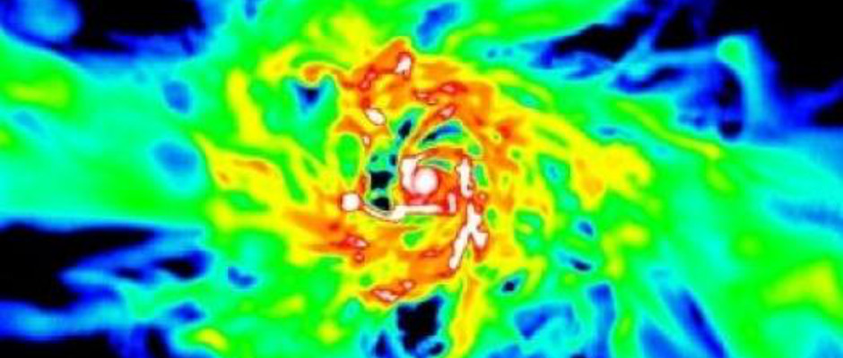 "This shows the gas density in a simulated galaxy at about 1 billion years after the Big Bang (redshift 6) with properties similar to those of the galaxies in the Hubble Space Telescope study just released. This includes an efficient rate of turning gas into stars. The simulated galaxy is being fed by streams of cold gas (green and yellow) flowing in along filaments from the cosmic web. This fuels the star formation occurring in the regions with the densest gas in this galaxy (red and white), mostly in the galaxy's centre but also in clumps around it. The gas in this galaxy has shrunk to a compact, star-forming ""blue nugget"" with a violently unstable, clumpy disc. Image credit: Avishai Dekel, Nir Mandelker, Daniel Ceverino, Joel Primack, and the VELA simulation team."