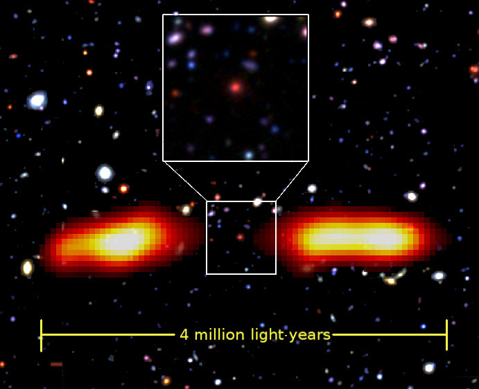 This is an optical image of J021659-044920 with radio lobes (in yellow-red) supimposed. The supermassive black hole in the red galaxy at the centre (zoomed-in inset) has led to the formation of the giant radio lobes. Image credit: Prathamesh Tamhane/Yogesh Wadadekar.