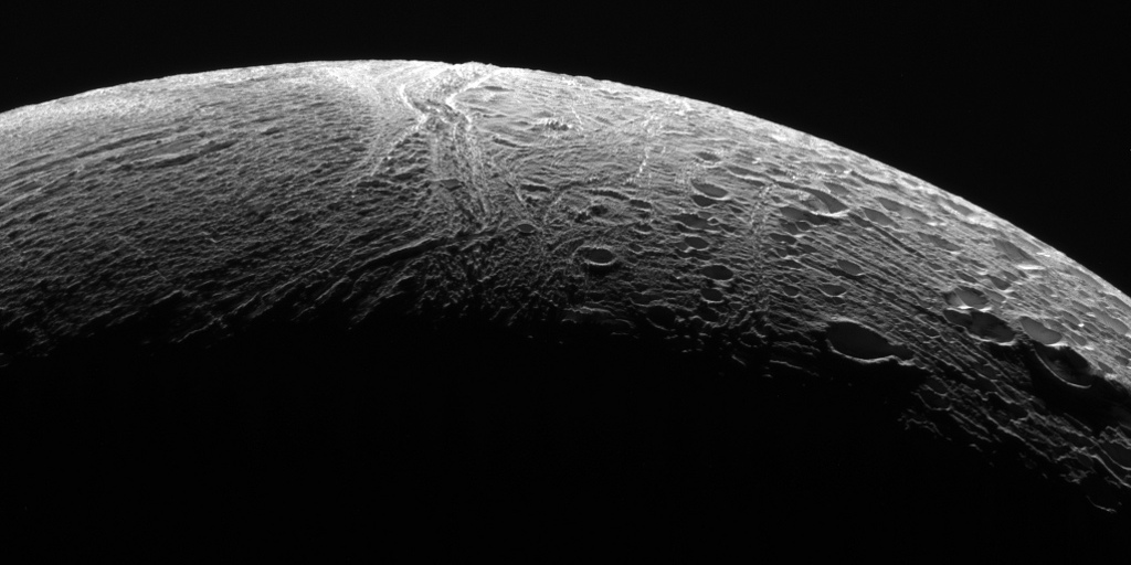 NASA's Cassini spacecraft peered out over the northern territory on Saturn's moon Enceladus, capturing this view of two different terrain types. A region of older terrain covered in craters that have been modified by geological processes is seen at right, while at left is a province of relatively craterless, and presumably more youthful, wrinkled terrain. Cassini acquired the view during its final close flyby of Enceladus, on 19 December 2015. North on Enceladus is up and rotated 38 degrees to the left. The image was taken in polarised green light with the Cassini spacecraft narrow-angle camera. The view was acquired at a distance of approximately 21,000 miles (34,000 kilometres) from Enceladus. Image scale is 668 feet (204 metres) per pixel. Image credit: NASA/JPL-Caltech/Space Science Institute.