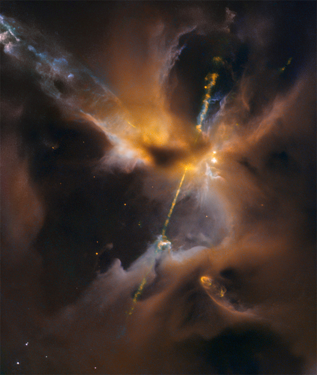 The two lightsabre-like streams crossing the image are jets of energised gas, ejected from the poles of a young star. If the jets collide with the surrounding gas and dust they can clear vast spaces, and create curved shock waves, seen as knotted clumps called Herbig-Haro objects. Image credit: ESA/Hubble & NASA, D. Padgett (GSFC), T. Megeath (University of Toledo), and B. Reipurth (University of Hawaii).