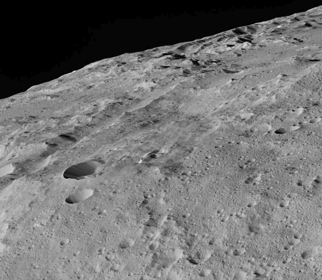 This image of dwarf planet Ceres was taken by NASA's Dawn spacecraft in its low-altitude mapping orbit around a crater chain called Gerber Catena. Image credit: NASA/JPL-Caltech/UCLA/MPS/DLR/IDA.