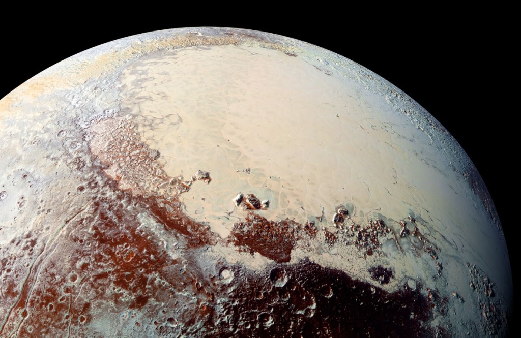 Looking across Pluto's Sputnik Planum and the mountains and craters that surround it. Image: NASA/JHUAPL/SwRI.
