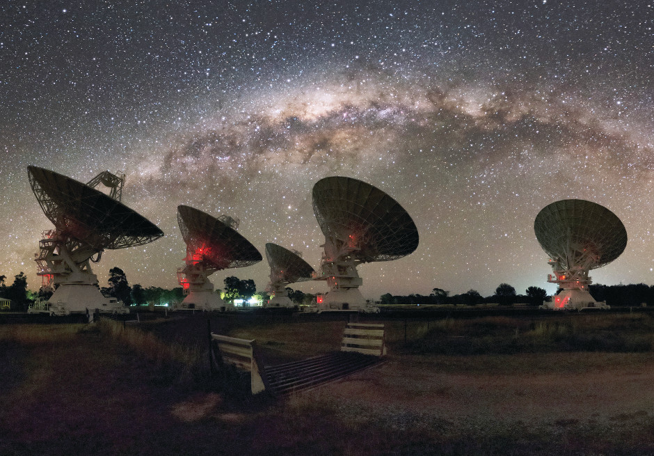 Five of the six 22-metre antennas comprising CSIRO's Compact Array in Australia under the night lights of the Milky Way. Image credit: Alex Cherney.
