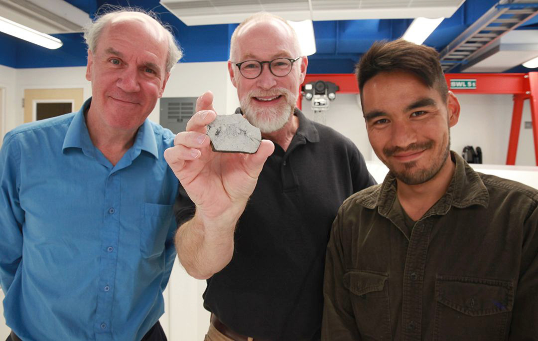 Paul Warren, Edward Young (holding a sample of a rock from the Moon) and Issaku Kohl. Image credit: Christelle Snow/UCLA.