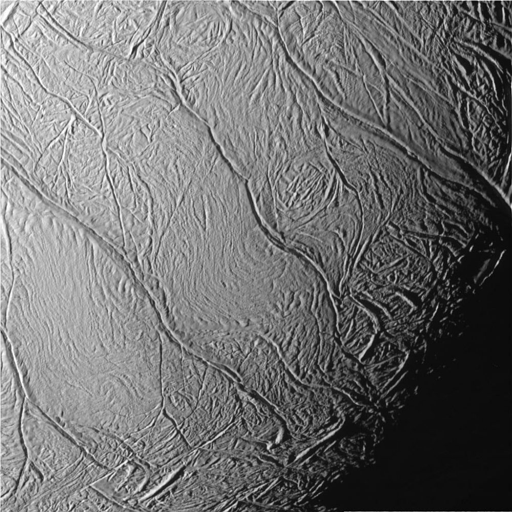 This close-up view of Saturn's moon Enceladus show a distinctive pattern of continuous, slightly curved and roughly parallel faults within the moon's southern polar latitudes. Informally called 'tiger stripes' by imaging scientists, they mark the source of the moon's long-lived geysers. Image credit: NASA/JPL/Space Science Institute.