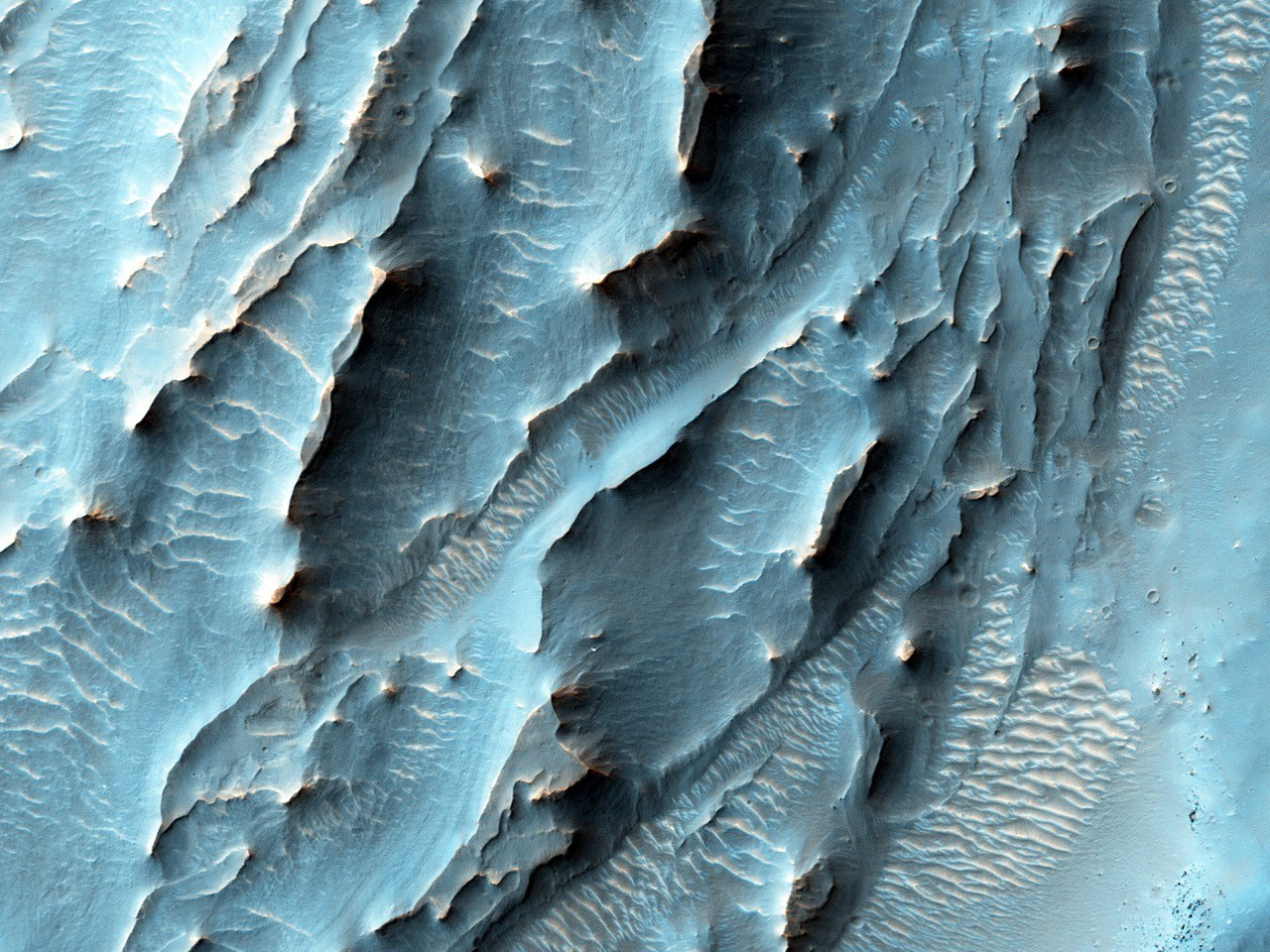 NASA's Mars Reconnaissance Orbiter, nearing the 10th anniversary of its arrival at Mars, used its High Resolution Imaging Science Experiment (HiRISE) camera to obtain this view of an area with unusual texture on the southern floor of Gale Crater. Image credits: NASA/JPL-Caltech/Univ. of Arizona.