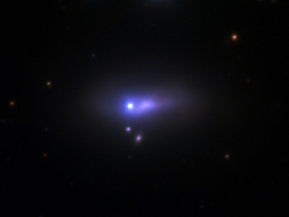 The blue-white dot at the centre of this image is supernova 2012cg, seen by the 1.2-metre telescope at Fred Lawrence Whipple Observatory. At 50million light-years away, this supernova is so distant that its host galaxy, the edge-on spiral NGC4424, appears here as only an extended smear of purple light. Image credit: Peter Challis/Harvard-Smithsonian CfA.