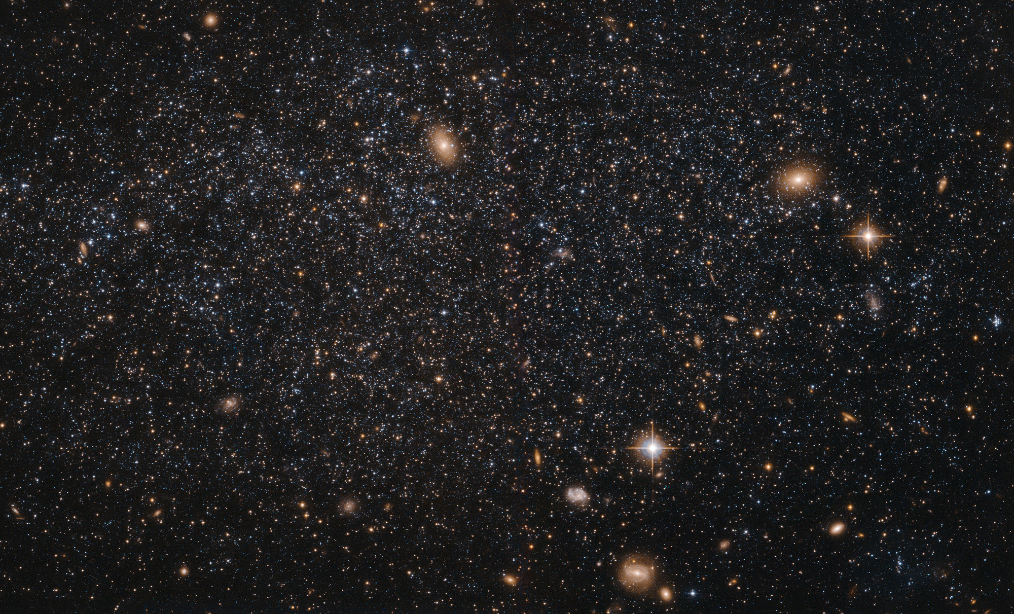 Local Group dwarf galaxy LeoA lies about 2.5million light-years from Earth. Its stars are so sparsely distributed that distant background galaxies are visible through it. Image credit: ESA/Hubble & NASA. Acknowledgement: Judy Schmidt.