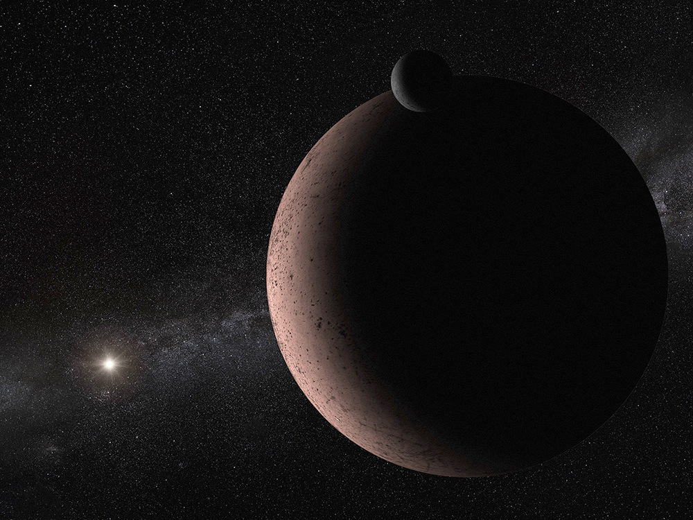 This artist's concept shows the distant dwarf planet Makemake and its newly discovered moon. Makemake and its moon, nicknamed MK2, are more than 50 times farther away than Earth is from the Sun. The pair resides in the Kuiper Belt, a vast reservoir of frozen material from the construction of our solar system 4.5billion years ago. Makemake is covered in bright, frozen methane that is tinted red by the presence of complex organic material. Its moon is too small to retain ices as volatile as methane, even given the feeble heating by the very distant Sun, and likely has a much darker surface. MK2 is orbiting 13,000miles from the dwarf planet, and its estimated diameter is roughly 100miles. Makemake is 870miles wide. Illustration credit: NASA, ESA, and A. Parker (Southwest Research Institute).
