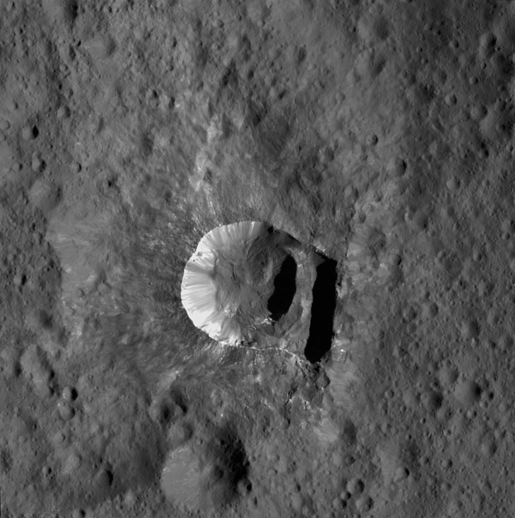 "Six-mile-wide (10-kilometre-wide) Oxo Crater is unique because of the relatively large ""slump"" in its crater rim. Image credit: NASA/JPL-Caltech/UCLA/MPS/DLR/IDA/PSI."